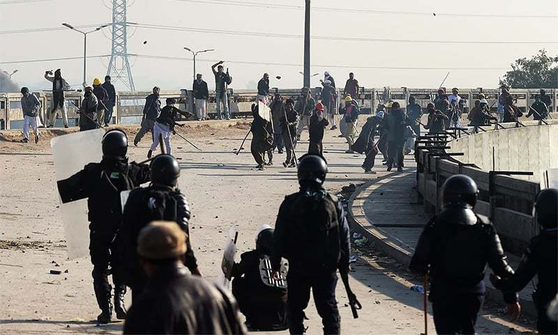 In this file photo, protesters from the Tehreek-i-Labbaik Yah Rasool Allah throw rocks toward riot policemen during a clash in Islamabad on November 25. — AFP/File