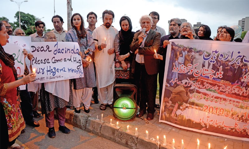 Civil society activists hold a vigil outside the National Press Club on Tuesday in memory of the victims of the terrorist attack at a vegetable market in Quetta's Hazarganji area. — Photo by Mohammad Asim