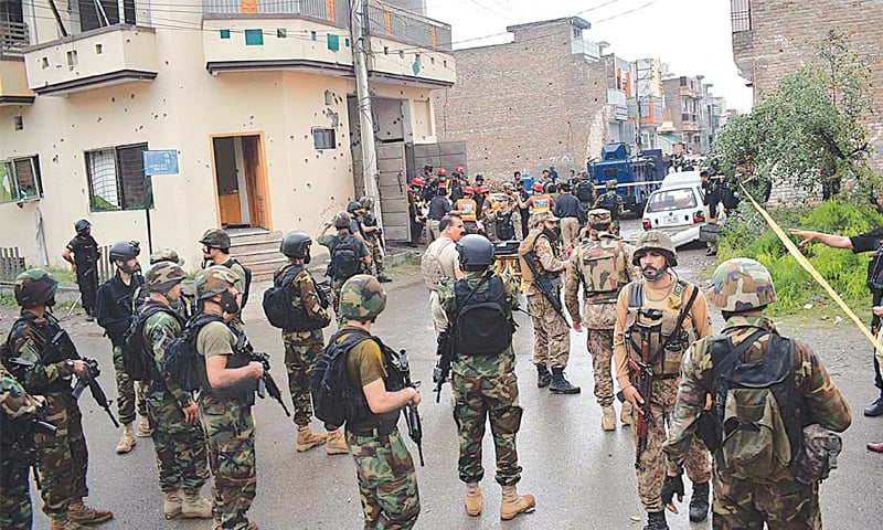 PESHAWAR: Security personnel pictured after the operation on Tuesday.—APP
