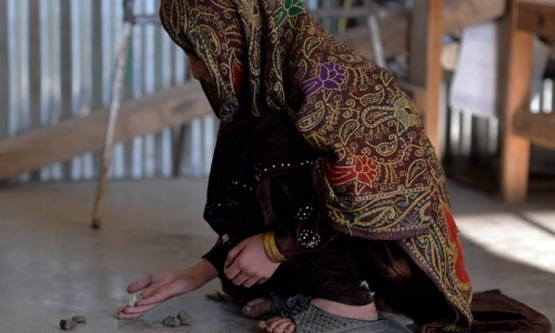 In this file photograph, a young girl, who escaped a forced marriage under a local custom, plays a local game. — AFP/File