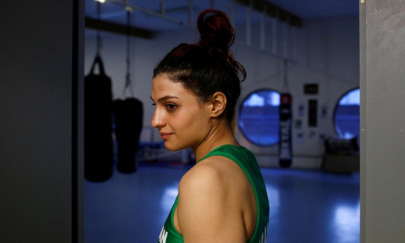 Iranian boxer Sadaf Khadem looks on before her fight against French boxer Anne Chauvin during an official boxing bout in Royan, France on April 13, 2019. —Reuters