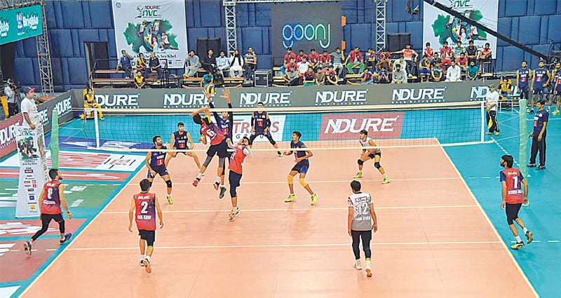 LAHORE: Players of Navy and Khyber Pakhtunkhwa in action during their National Volleyball Championship match on Wednesday.—APP