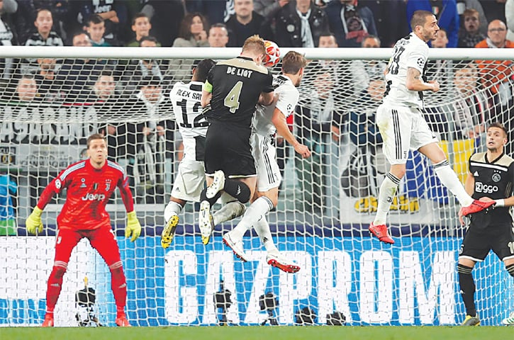TURIN: Ajax's Matthijs de Ligt (third L)) heads to score during the UEFA Champions League quarter-final second leg against Juventus at the Allianz Stadium.—AFP