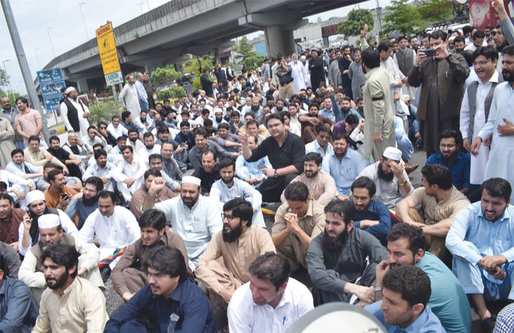 Doctors stage a protest outside KP Assembly building in Peshawar on Wednesday against government plan to set up district and regional health authorities. — White Star
