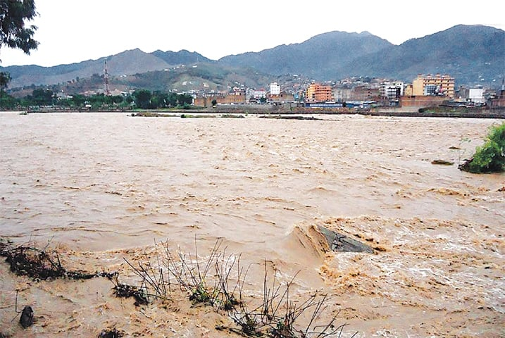 LOWER DIR: A flash flood hit the River Panjkora near Timergara town, in Lower Dir, after heavy rains lashed the Malakand division. The Khyber Pakhtunkhwa irrigation department said the river was in medium flood and water flow stood at 24,301 cusec over the past 24 hours. The Panjkora River originates from the mountains of Upper Dir and its name refers to five tributaries that make up the river. It joins the River Swat near Busak.—INP