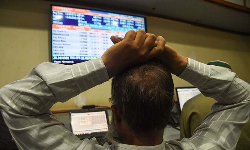 A Pakistani stockbroker monitors share prices during a trading session at the Pakistan Stock Exchange in Karach. ─ AFP/File