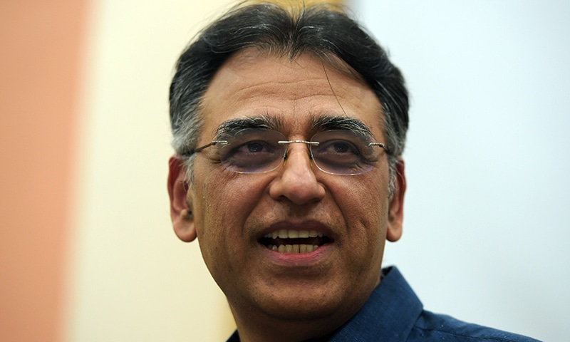 Finance Minister Asad Umar speaks to the media during a press conference, after stepping down from his ministry, in Islamabad on Thursday. — AFP