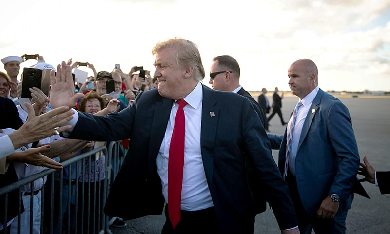 US President Donald Trump greets supporters on the tarmac at Palm Beach International Airport, as he arrives to spend Easter weekend at his Mar-a-Lago club, in West Palm Beach, Florida, April 18. — Reuters