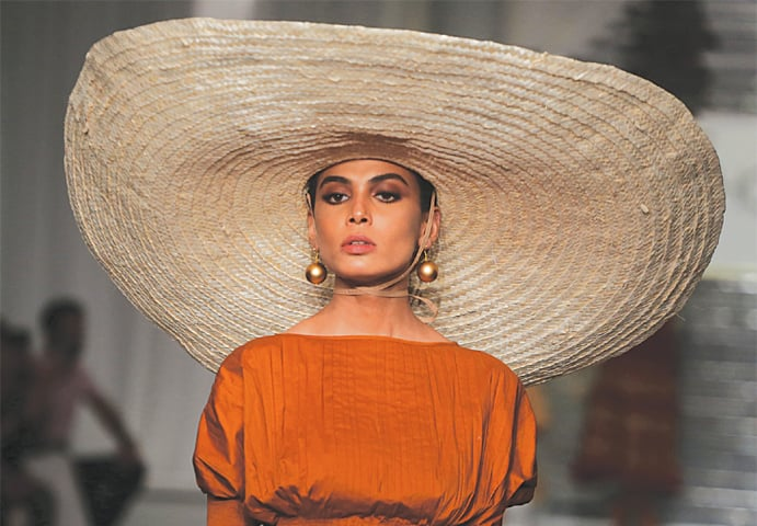 A MODEL wears a creation by opening designer Zaheer Abbas on the first day of the three-day Hum Showcase at a local hotel on Thursday.—Shakil Adil/White Star