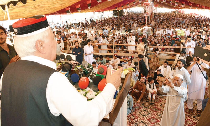 QWP chief Aftab Sherpao addresses a party function in Charsadda on Friday. —Dawn