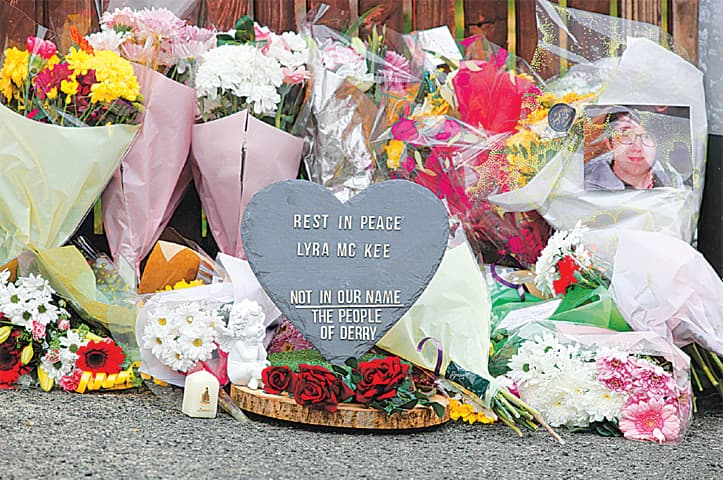 DERRY (Northern Ireland): Flowers and a plaque are seen on Friday at the scene where a journalist was fatally shot.—AFP