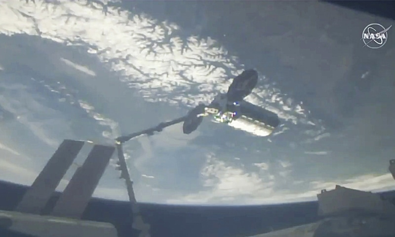 A cargo ship arrives at the International Space Station on Friday.—AP