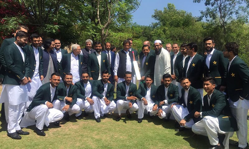 Prime Minister Imran Khan takes a photograph with the Pakistan cricket team at Bani Gala. ─ Photo courtesy PTI Twitter