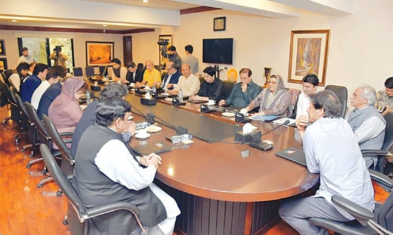 PRIME Minister Imran Khan presiding over a meeting of the senior members of the Pakistan Tehreek-i-Insaf, coalition partners and newcomers in his government team at his Banigala residence on Saturday.—Dawn