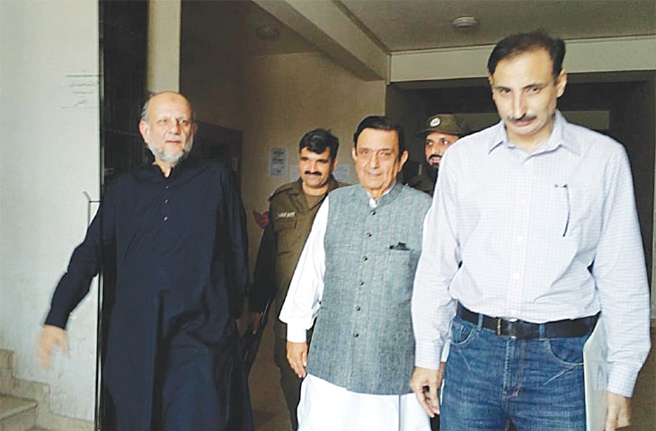 ISLAMABAD: Former petroleum secretary Shahid Rafi leaving the NAB court after a hearing in the Karkey rental power plant case on Saturday.—Online