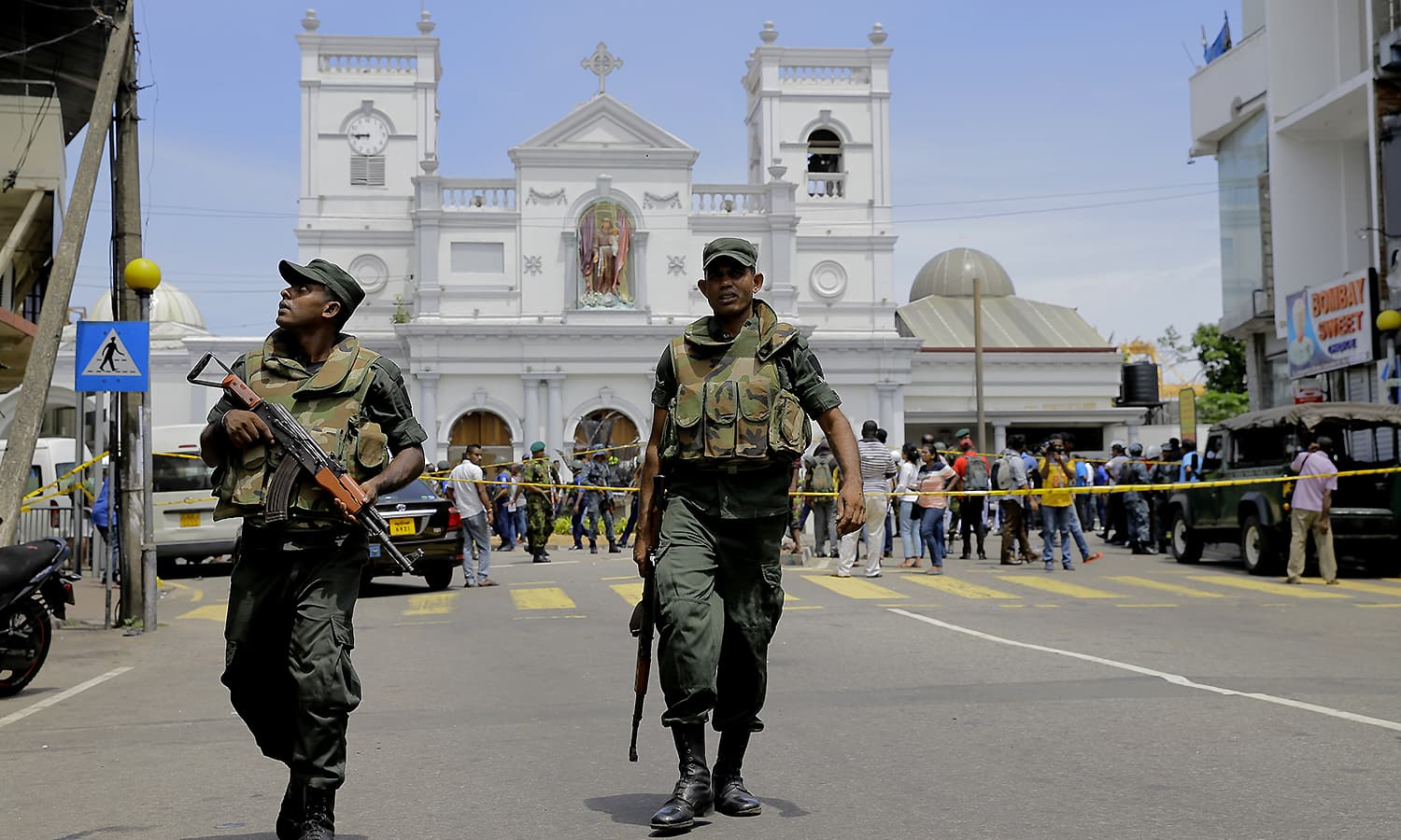 Sri Lankan soldiers secure the area around St. Anthony's Shrine after a blast in Colombo. ─ AP