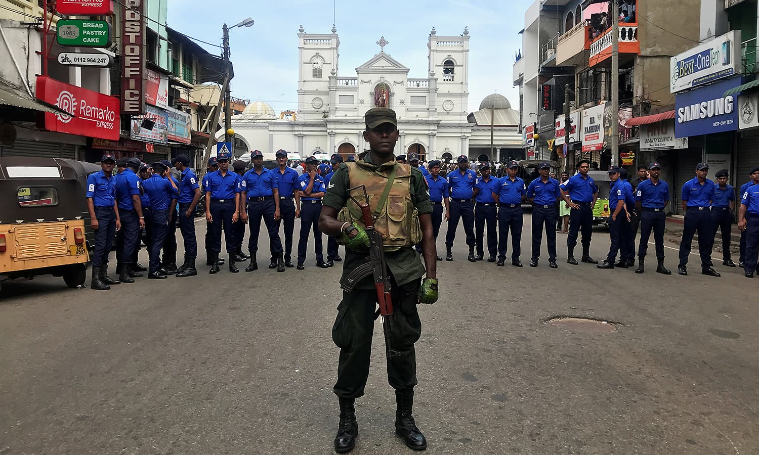 Sri Lankan military officials stand guard in front of the St Anthony's Shrine. ─ Reuters