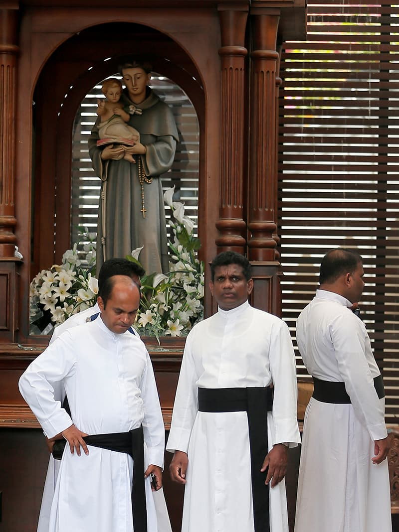Priests are seen inside St Anthony's Shrine, Kochchikade church after an explosion in Colombo. ─ Reuters