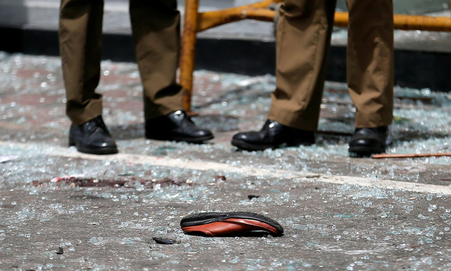 A shoe of a victim is seen in front of the St. Anthony's Shrine after an explosion in Colombo, Sri Lanka  on April 21, 2019. ─ Reuters