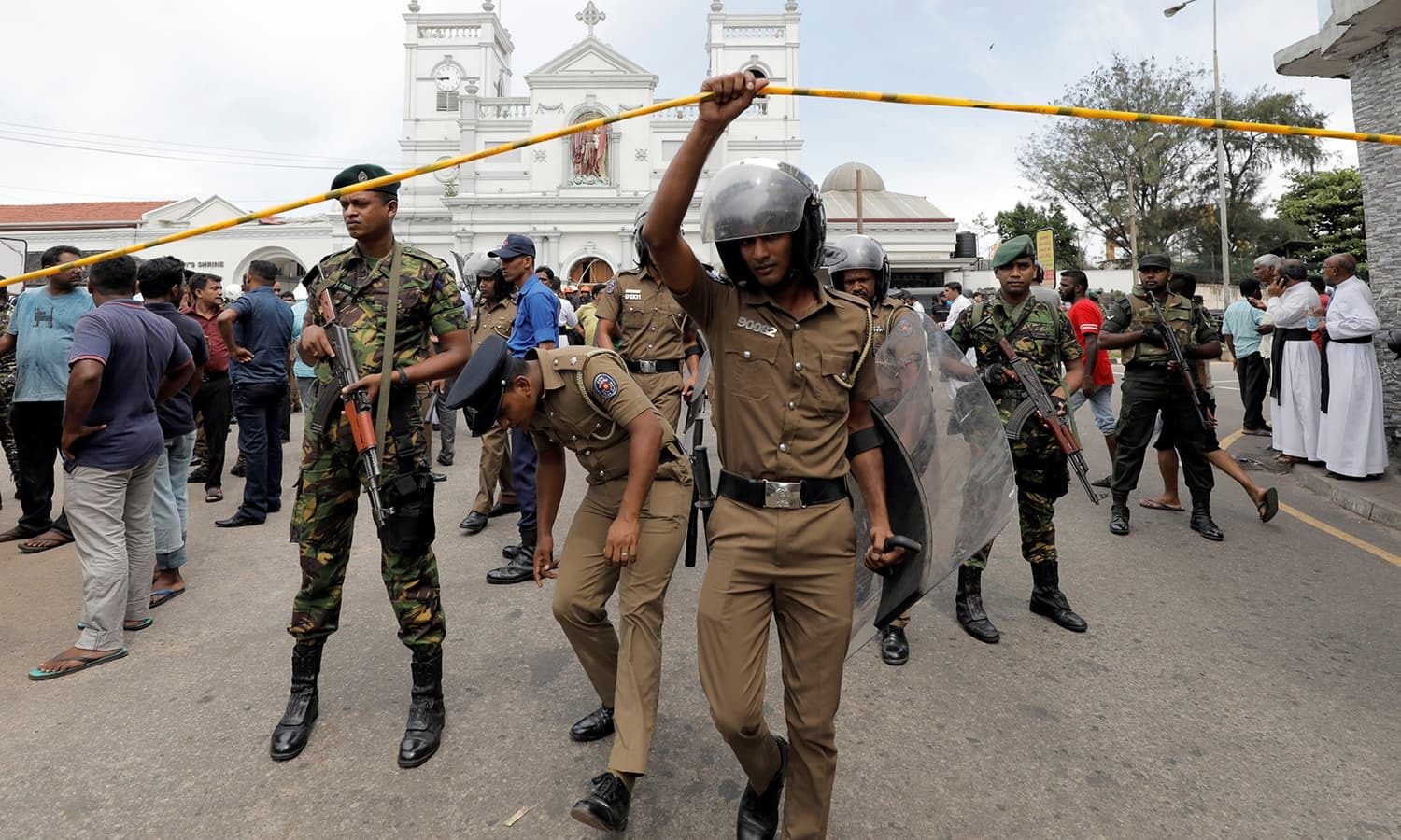 Sri Lankan military officials stand guard in front of the St. Anthony's Shrine. ─ Reuters