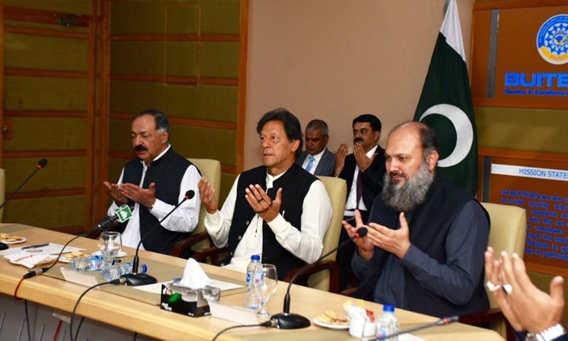 Prime Minster Imran Khan (C) offers Fatiha for the victims of the Hazarganji blast in Quetta on Sunday. — Photo courtesy PTI official Twitter