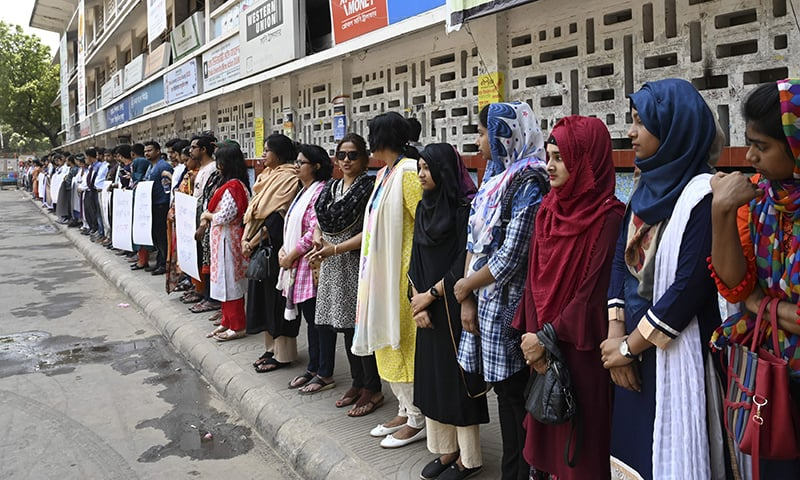 Members of the Transparency International Bangladesh group stand in a human chain during a protest in Dhaka on April 21, following Nusrat Jahan Rafi's murder by being set on fire after she had reported a sexual assault. — AFP
