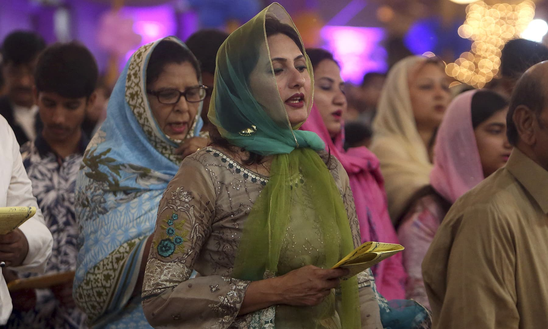 Christians attend early morning Easter mass at St Patrick's Church in Karachi. — AP