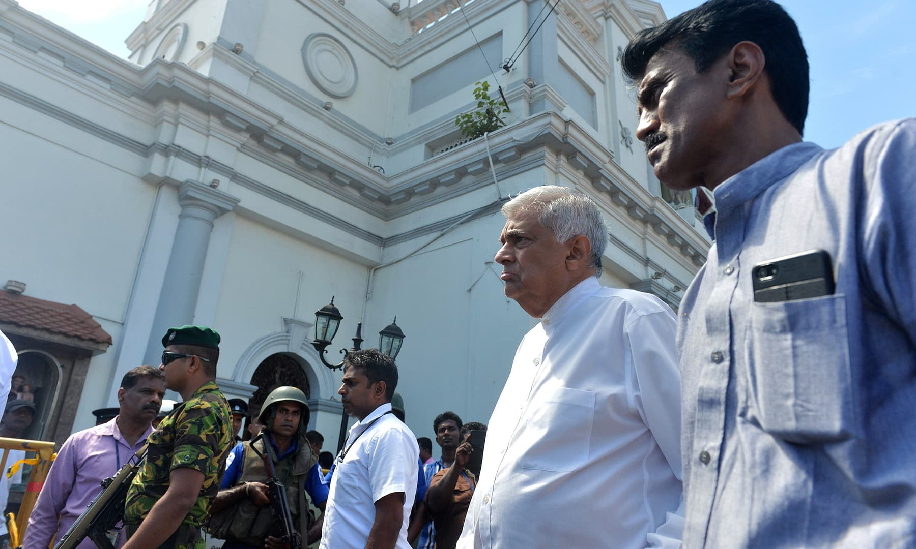 Sri Lankan Prime Minister Ranil Wickremasinghe (2nd R) arrives to visit the site of a bomb attack at St. Anthony's Shrine in Kochchikade in Colombo. — AFP