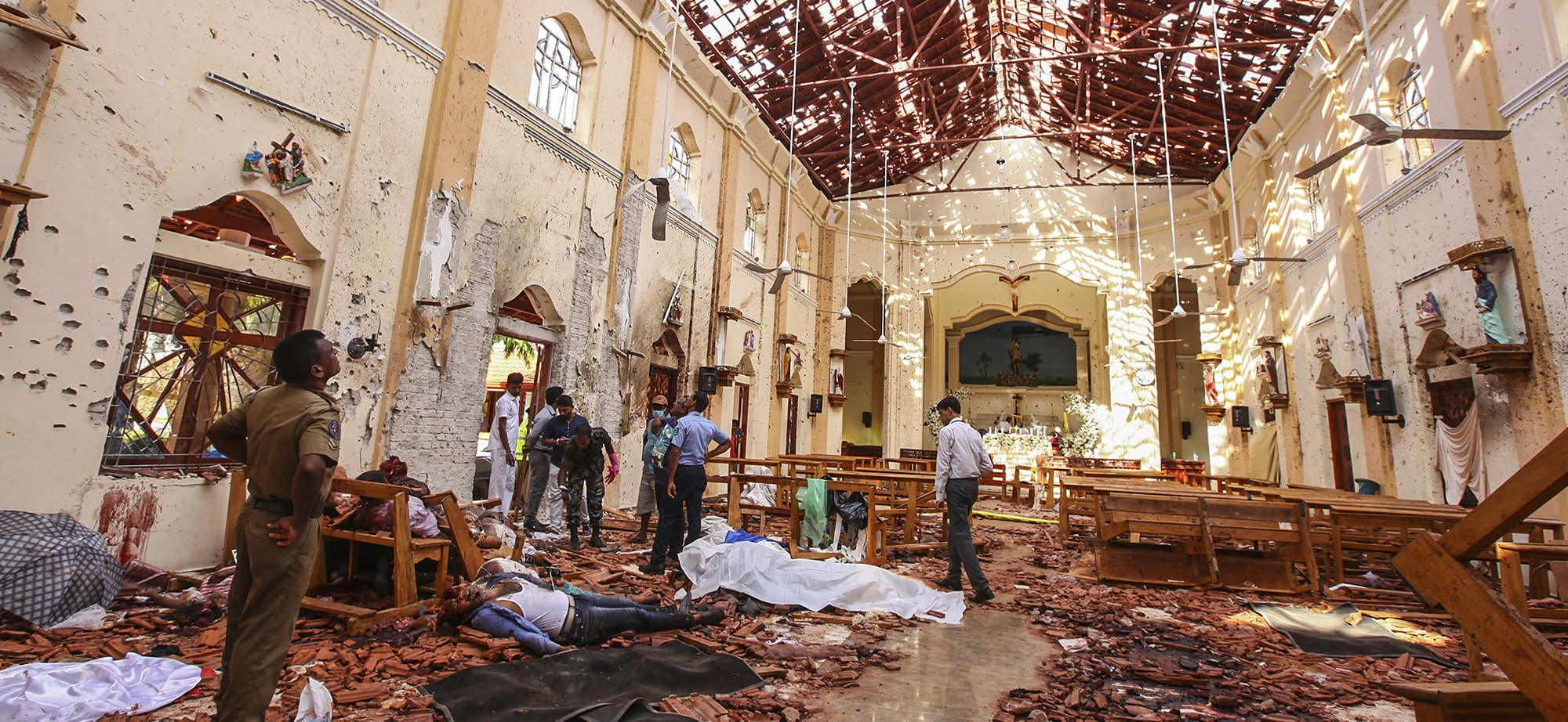 Dead bodies of victims lie inside St. Sebastian's Church damaged in blast in Negombo, north of Colombo, Sri Lanka, Sunday, April 21, 2019.  More than two hundred people were killed and hundreds more injured in eight blasts that rocked churches and hotels in and just outside Sri Lanka's capital on Easter Sunday. (AP Photo/Chamila Karunarathne) — Copyright 2019 The Associated Press. All rights reserved.