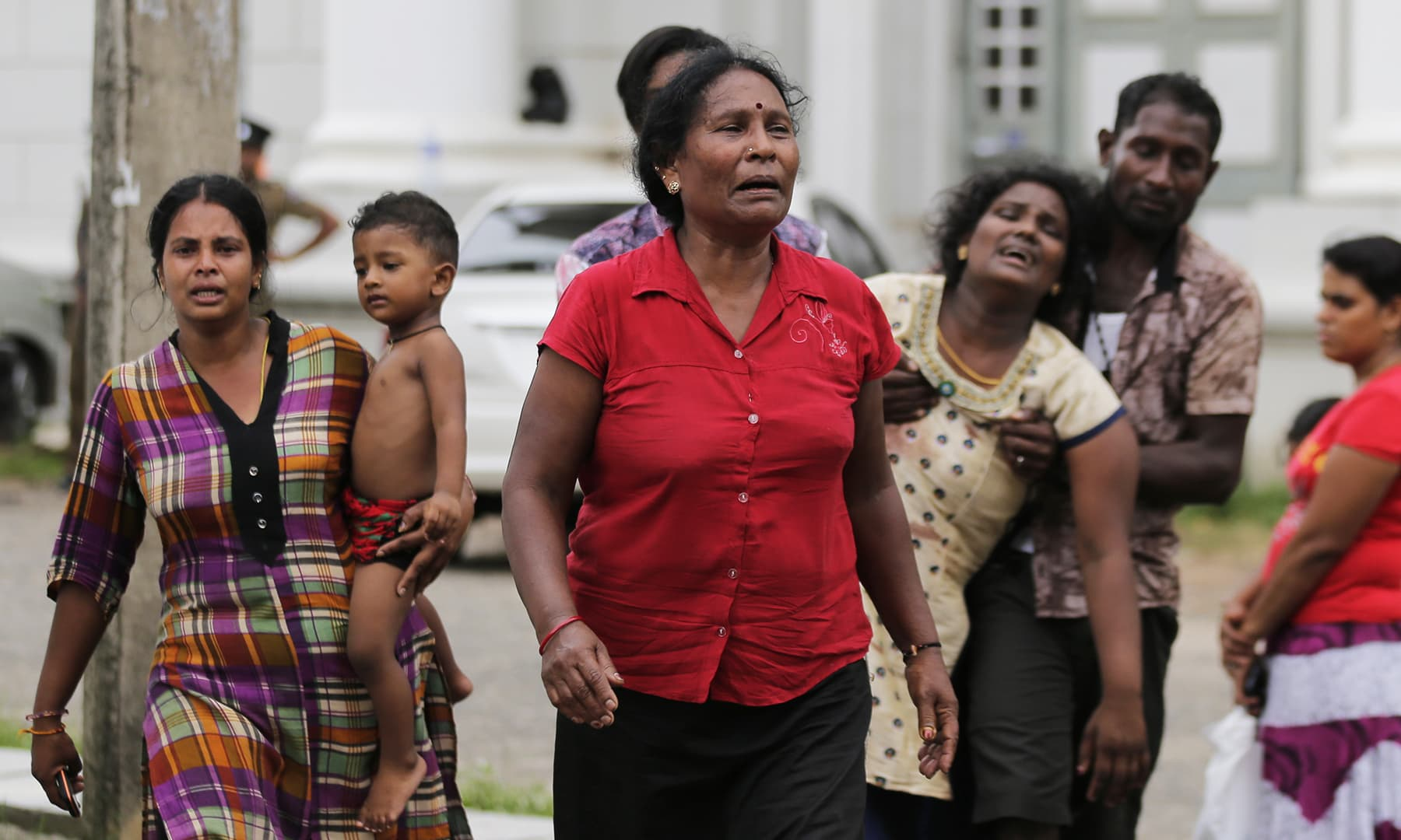 Relatives of a blast victim grieve outside a morgue in Colombo. — AP