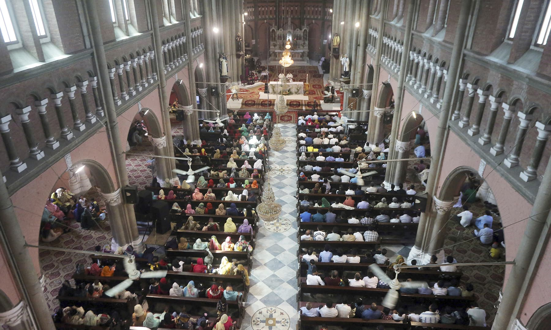 Christians attend Easter mass at Catholic Sacred Heart Cathedral in Lahore. — AP
