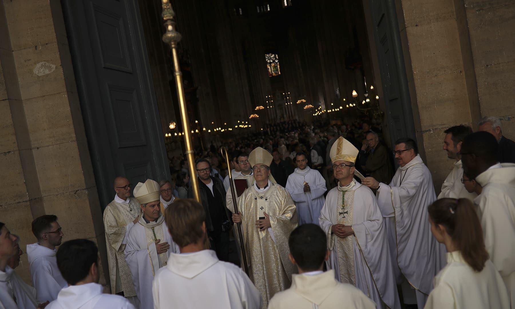 Paris Archbishop Michel Aupetit, center, leads a Sunday's Mass at the grandiose Saint-Eustache church in Paris. — AP