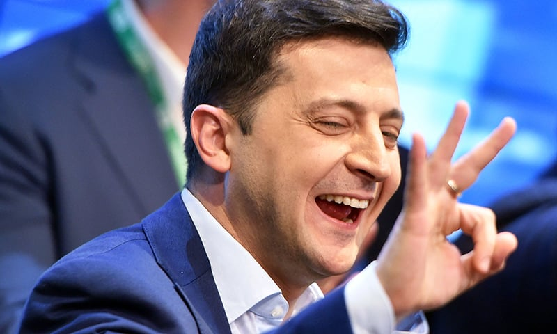 Ukrainian comedian and presidential candidate Volodymyr Zelensky reacts after the announcement of the first exit poll results in the second round of Ukraine's presidential election at his campaign headquarters in Kiev on April 21. — AFP