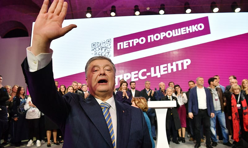 Ukrainian President Petro Poroshenko gestures as he and his team thank his supporters at the party headquarters in Kiev on April 21. — AFP