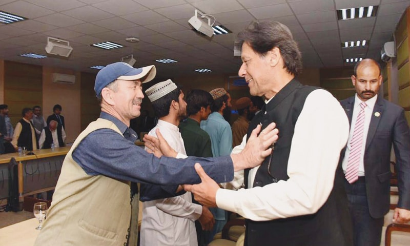 QUETTA: A member of the Hazara community greets Prime Minister Imran Khan on Sunday.—PPI
