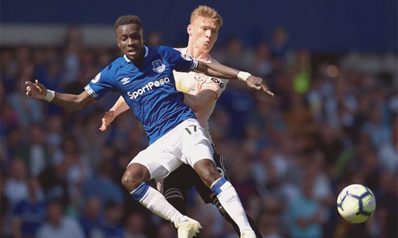 LIVERPOOL: Everton's Idrissa Gueye (L) is pressured by Manchester United's Scott McTominay during their English Premier League match at Goodison Park on Sunday.—AFP