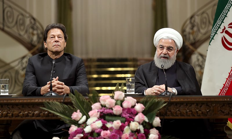 Prime Minister Imran Khan and Iranian President Hassan Rouhani address a joint press conference after talks. — Photo by Iranian Presidency / AFP