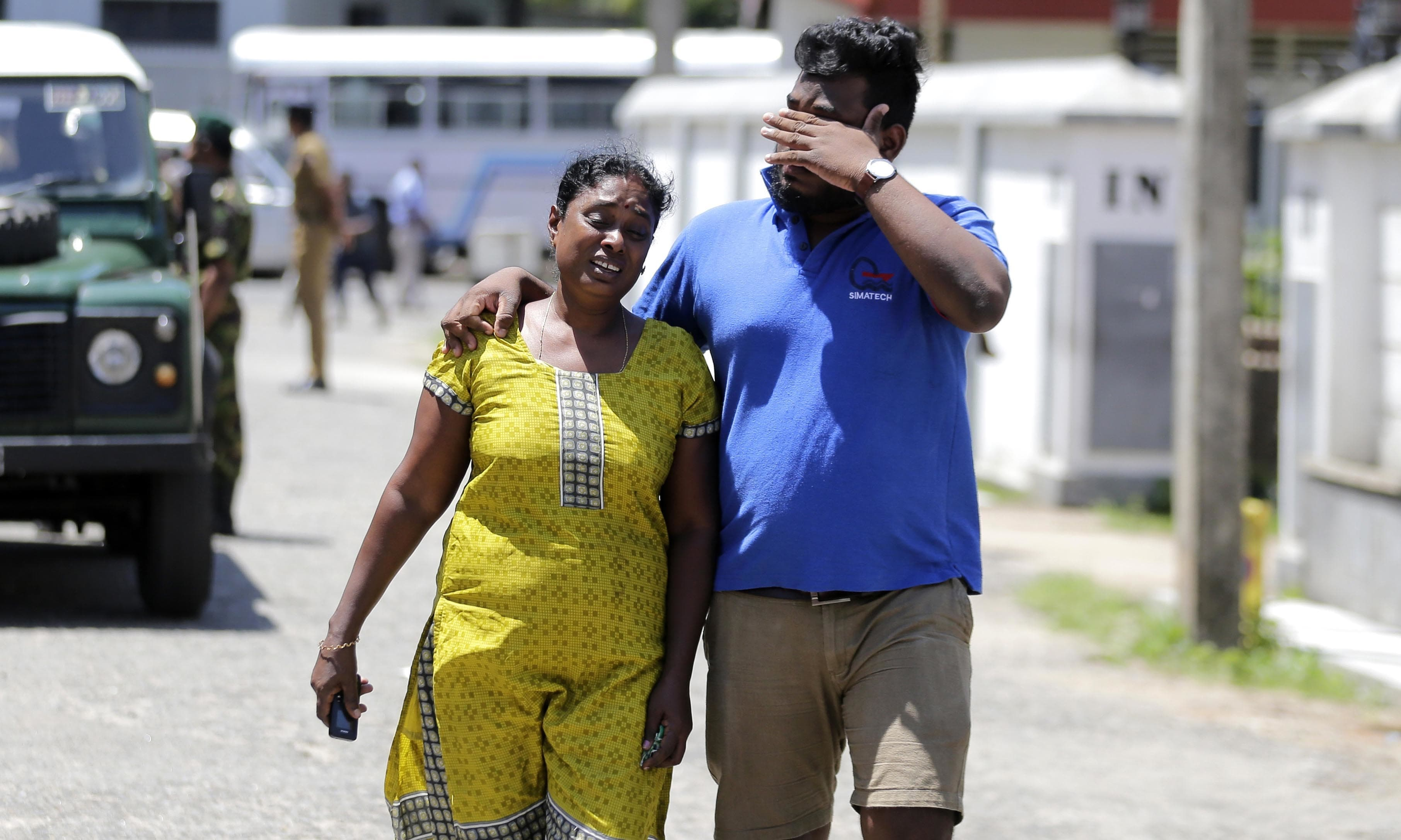 A Sri Lankan couple mourns as they leave from a mortuary after identifying the body of their relative killed in a blast, in Colombo, Sri Lanka. — AP
