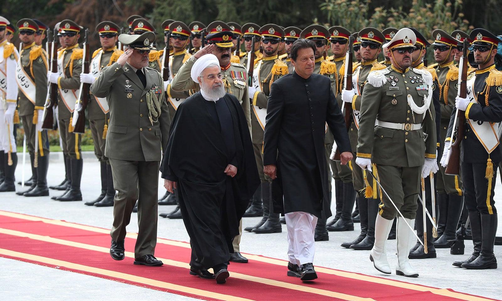 ایرانی صدر کی جانب سے وزیراعظم عمران خان کے اعزازمیں استقبالیہ دیا گیا—فوٹو:اے ایف پی
