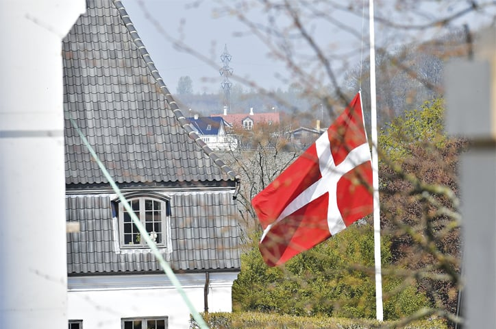 The Danish flag flies at half mast at billionaire Anders Holch Povelsen's home south of Aarhus, Denmark, on Monday.—AP