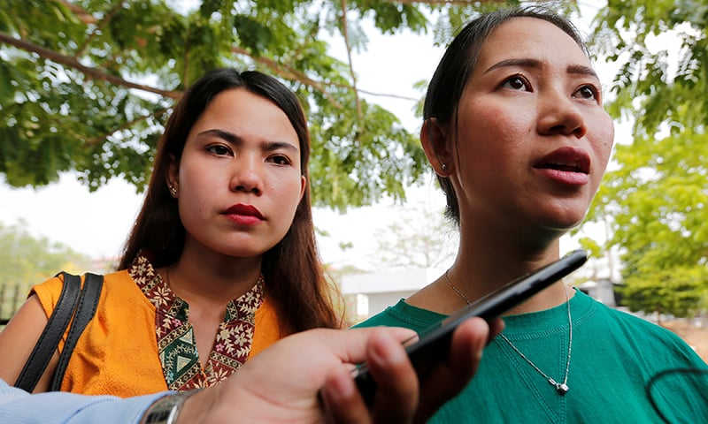 Pan Ei Mon (R) and Chit Su Win, the wives of jailed Reuters reporters Wa Lone and Kyaw Soe Oo speak to media outside the court in Naypyidaw, Myanmar. ─ Reuters