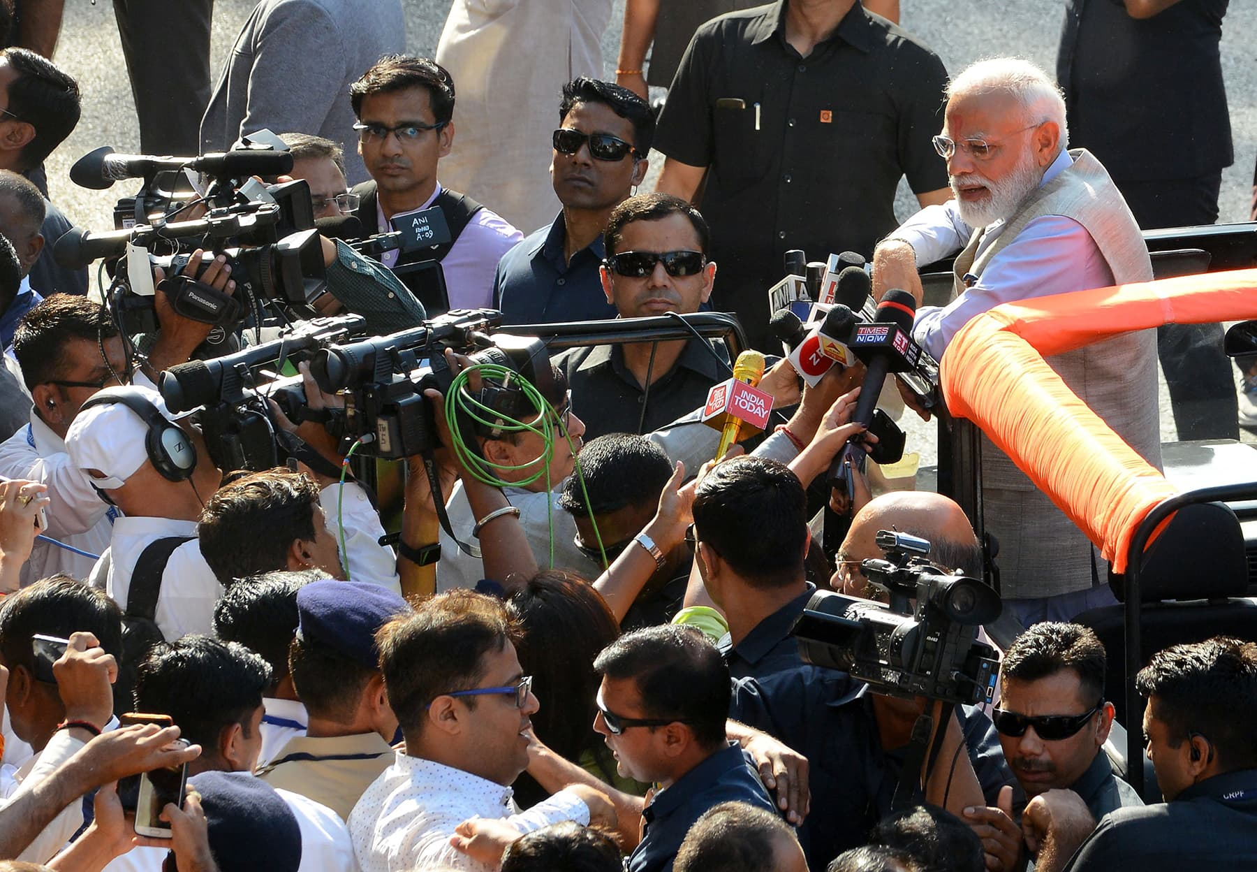 Indian Prime Minister Narendra Modi speaks to media after casting his vote. — AFP