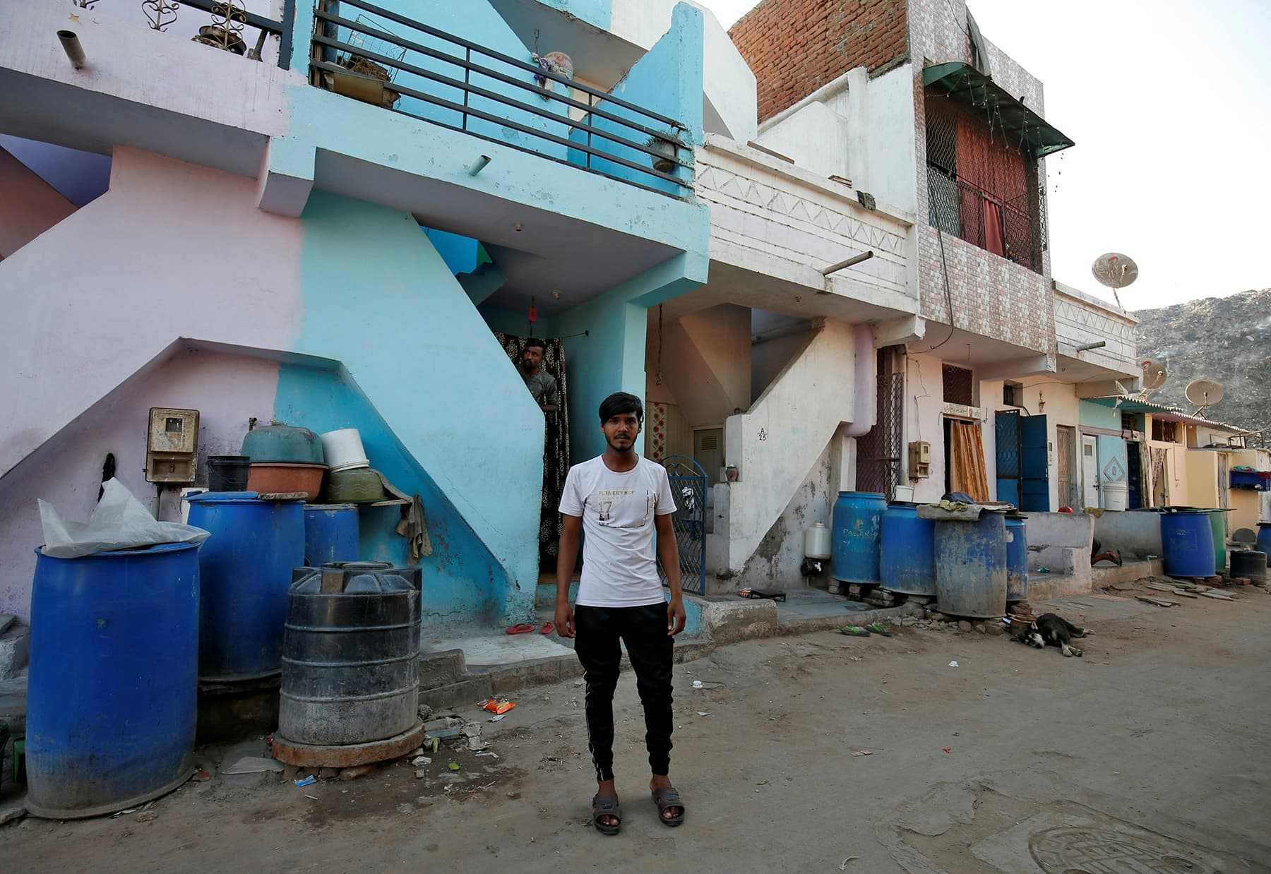 Mohammad Rafiq, 18, poses outside his house in Ahmedabad, April 12. — Reuters