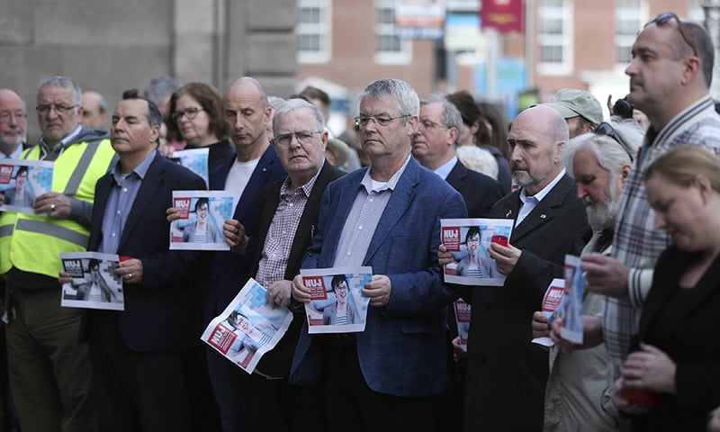 People gather during a vigil for murdered journalist 29 year-old Lyra McKee, in Dublin, Ireland, Tuesday April 23. — AP
