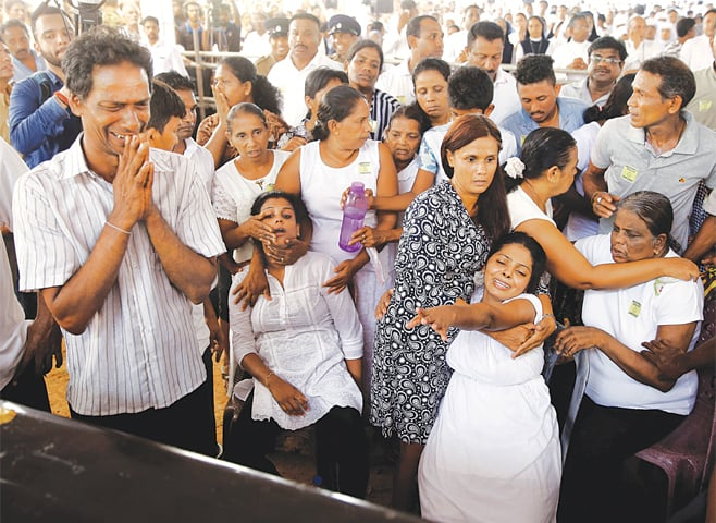 NEGOMBO (Sri Lanka): Mourners attend a mass for victims of the bomb attacks on churches and hotels across Sri Lanka on Easter. The militant Islamic State group claimed responsibility on Tuesday for the attacks that left 321 people dead. President Maithripala Sirisena has said he will sack the heads of security agencies for their failure to act on intelligence reports that a terror strike was imminent.—Reuters