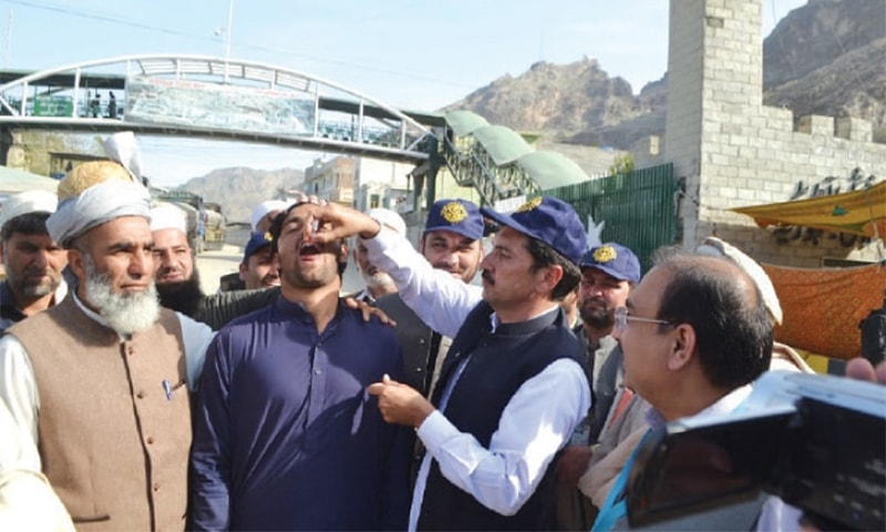 An Afghan national is administered the anti-polio vaccine at the Torkham border. ─ Dawn/File