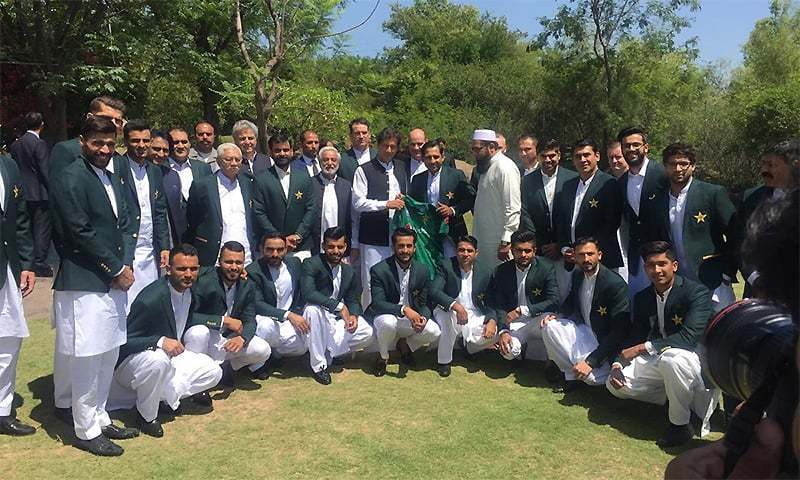 Prime Minister Imran Khan takes a photograph with the Pakistan cricket team at Bani Gala on April 19. ─ Photo courtesy PTI Twitter/File