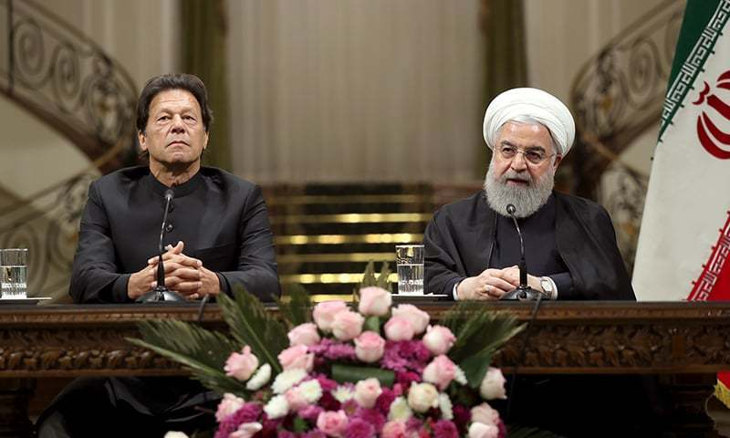In this file photo, Prime Minister Imran Khan and Iranian President Hassan Rouhani address a joint press conference after talks on Monday. — Photo by Iranian Presidency / AFP