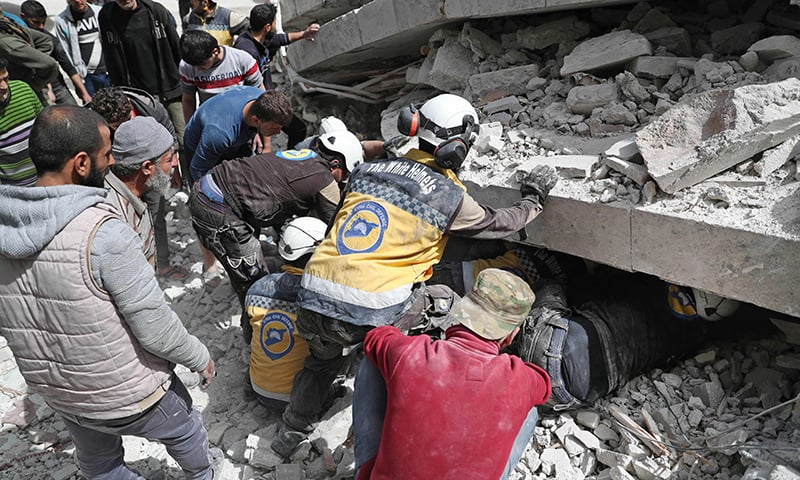 "Members of the Syrian Civil Defence, also known as the ""White Helmets"", search the rubble of a collapsed building following an explosion in the town of Jisr al-Shughur, in the west of the mostly rebel-held Syrian province of Idlib, on April 24, 2019. — AFP"