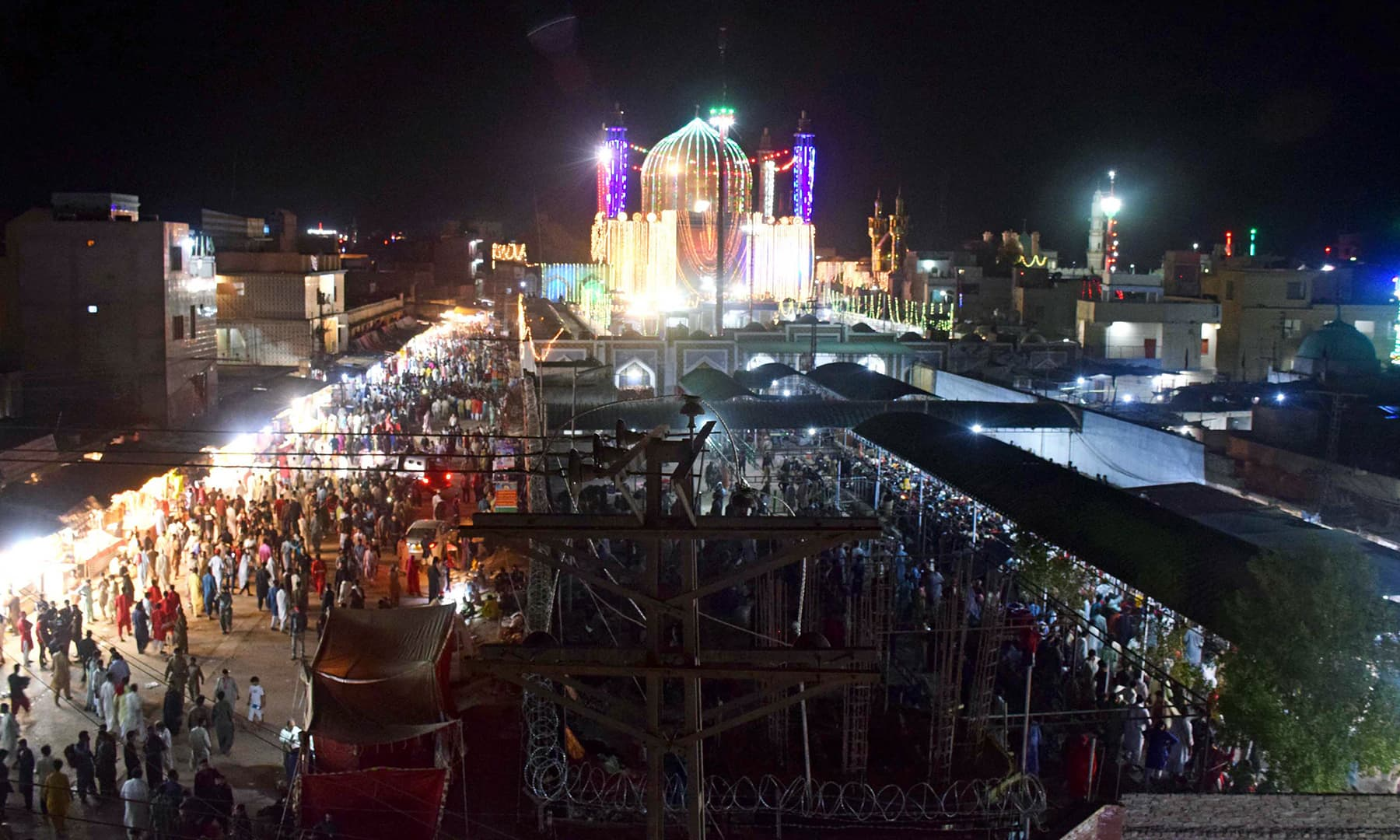 A night view of the dome of Qalandar's shrine from the golden gate side.
